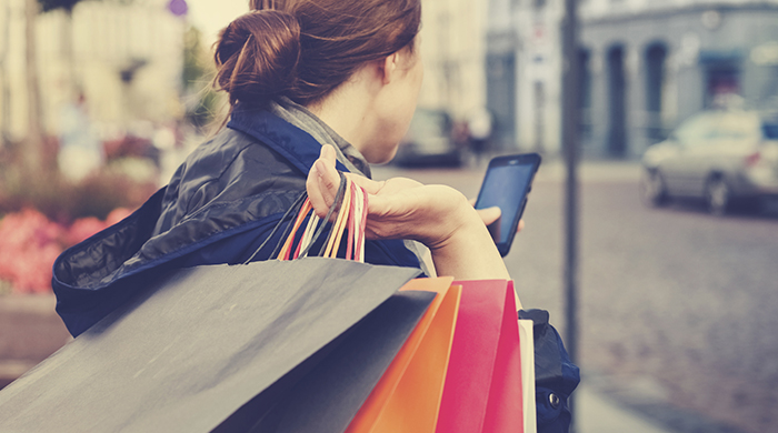 Redheaded Woman Holding Shopping Bags