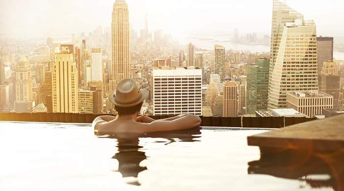 Man in Hotel Rooftop Pool