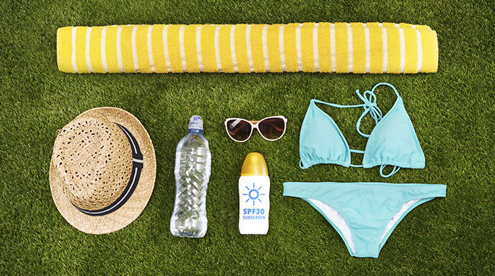 Beach Blanket and Bikini on Grass