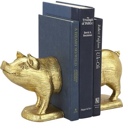 Gold pig bookends holding a blue book
