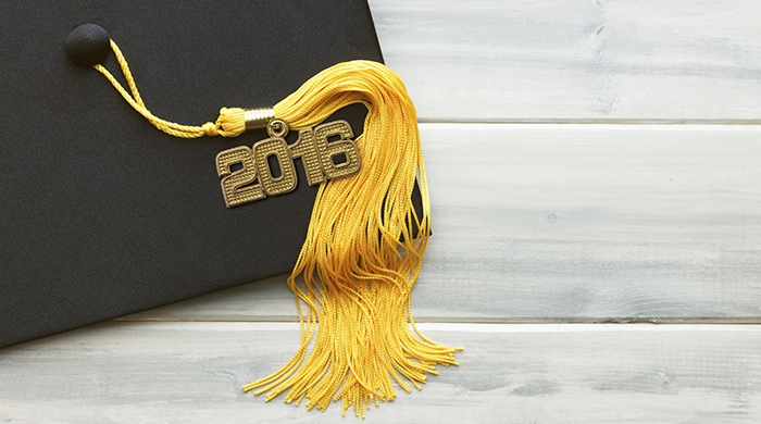 Black mortar board hat and gold tassel for graduation