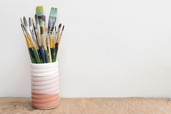 Paintbrushes in a glass on the table