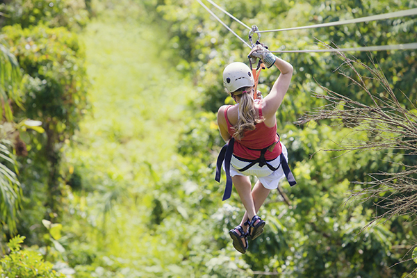 Woman on zipline in the forest