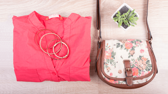 Lay flat of coral blouse with bangles and floral bag OOTD