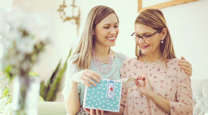 Woman giving her mom a mother's day gift