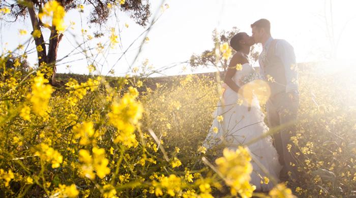 Interracial bride and groom couple summer wedding