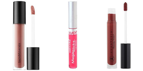 Three lip glosses in gold, pink, and wine