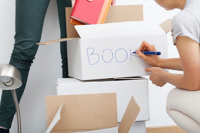 Woman descripting boxes