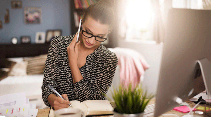 Woman in glasses working in home office