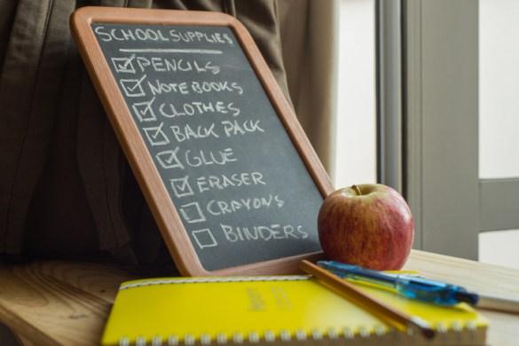 List of school supplies on a blackboard