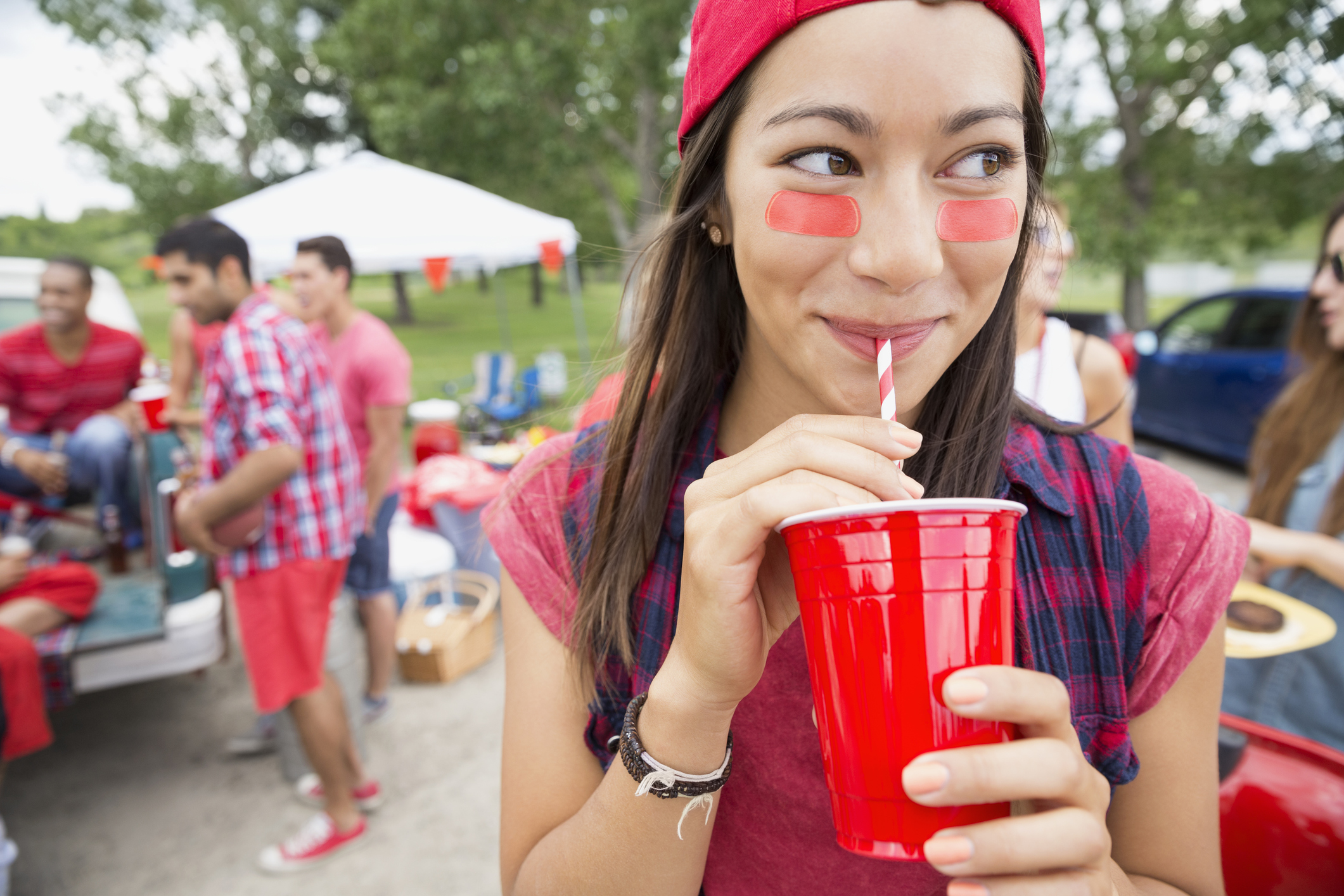 Woman drinking at barbecue tailgate