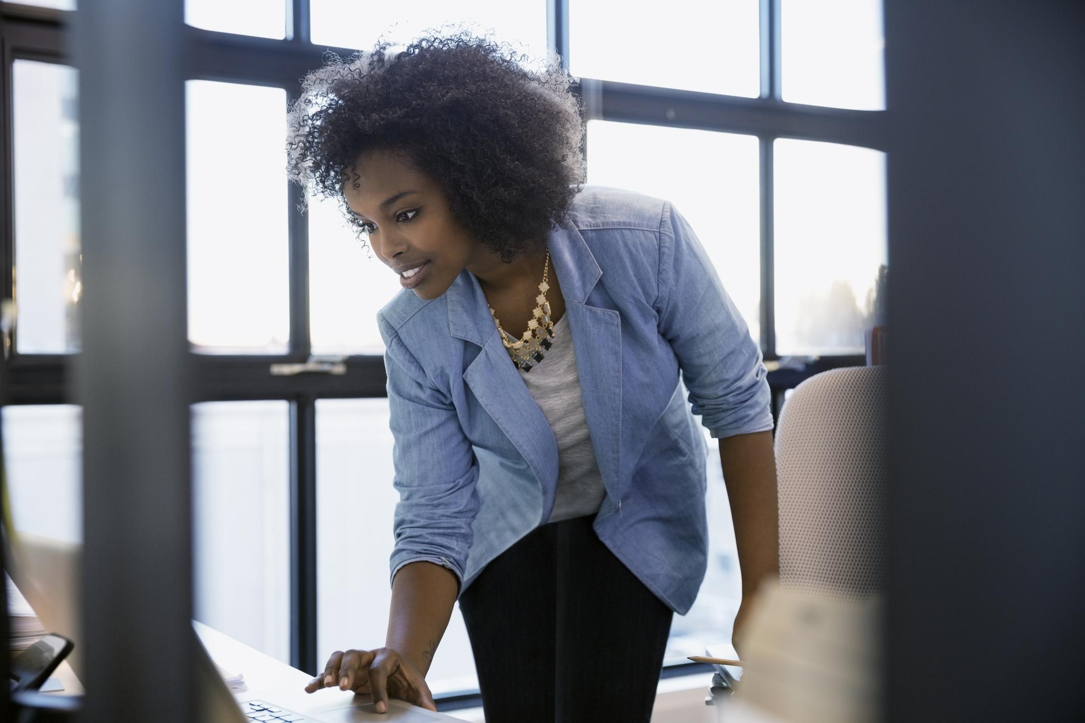 Woman in blue blazer working in office