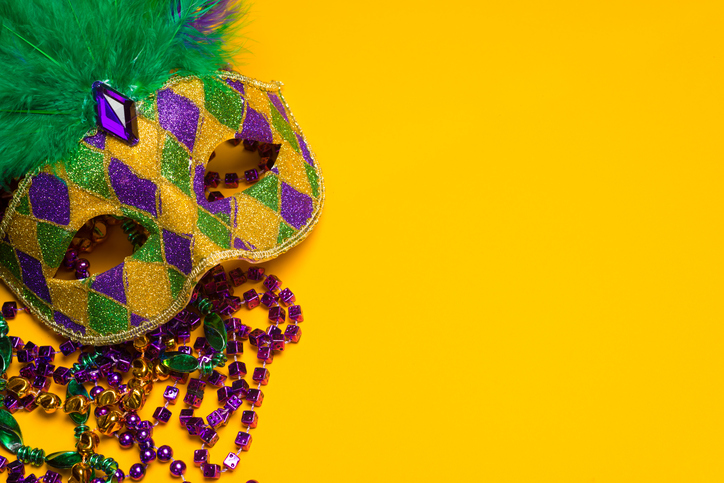 Colorful Mardi Gras or venetian mask on a yellow