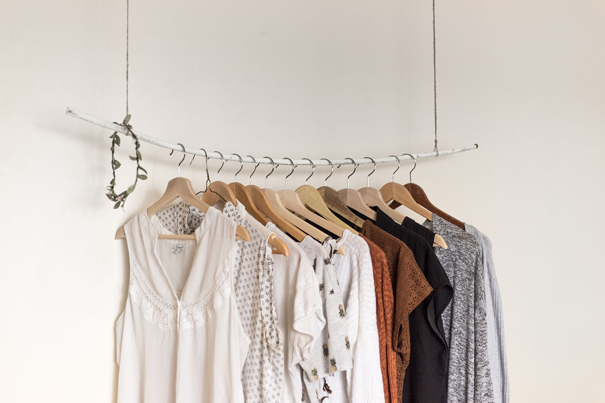 Clothes hanging on a wooden rack