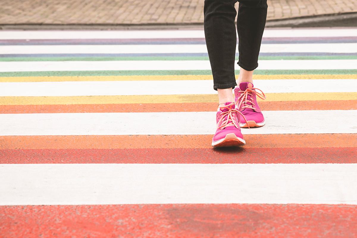 Walking on a rainbow crosswalk