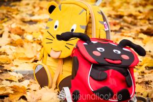 Zwei süße Rucksäcke als Tiger und Marienkäfer