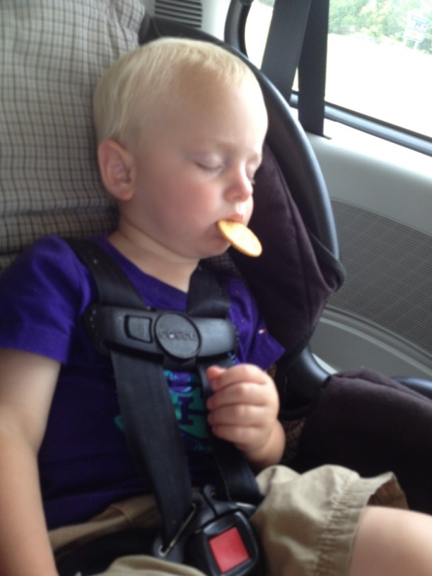On our way back. This little boy was so tired he fell asleep while eating a cracker.