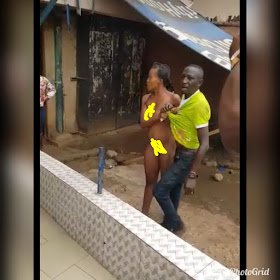 Unclad lady fights a man who slept with her without payment(Photos)
