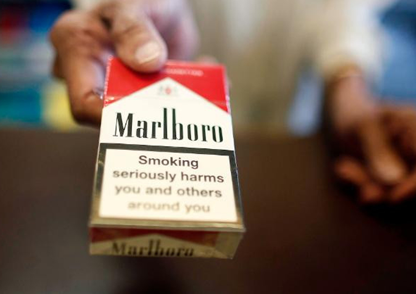 Philip Morris International says it will stop selling Marlboro cigarettes in Britain within the next ten years as it called on the UK government to ban the sale of its tobacco products