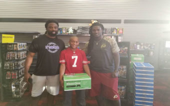 10-year-old Jaden Watts with Washington Redskins players Keith Marshall and Rob Kelley