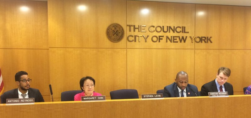 City Council member Margaret Chin (flanked by members of the Council's Zonings and Franchises Subcommittee) originally opposed the plan to allow Water Street building owners to convert 2.6 acres of public space inside arcades to private, retail use, but endorsed a modified version of the proposal, which the panel unanimously voted to support on Tuesday.