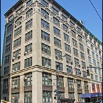 The existing building at 137 Centre Street, once known as the Excelsior, currently hosts the Department of Sanitation and NYPD.