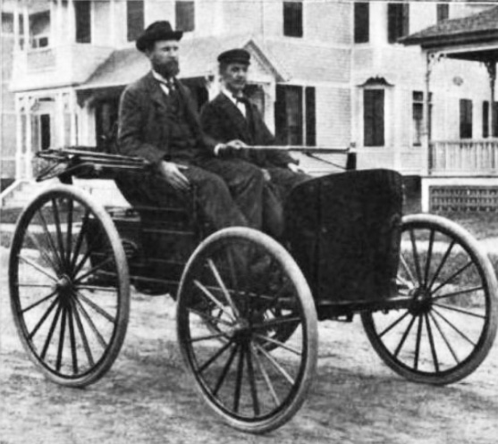 Charles Duryea and his brother J. Frank  in their 1894 gasoline-powered automobile