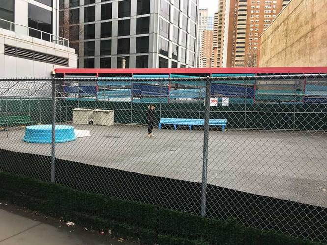 The dog run on Warren Street, which occupies the southern half of a Tribeca lot that has been troubled by substandard pilings beneath the surface, while the City's Parks Department has delayed making repairs.