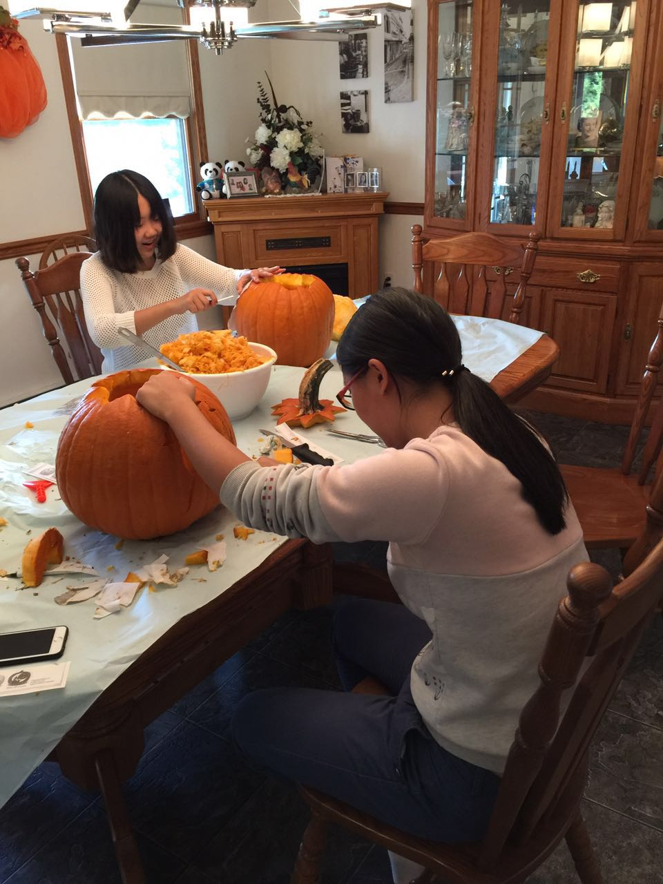 Vicky and Cecilia Carving Pumpkins