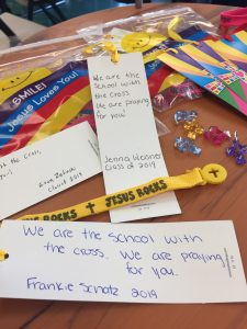 High school students create gift bags for younger students for CSW service project