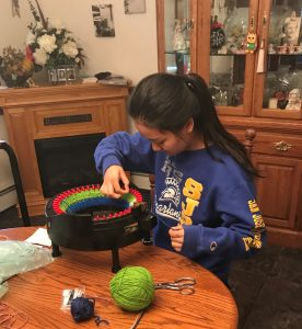 High school student makes hats for the homeless