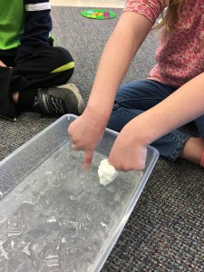 Preschool students learn about different types of weather