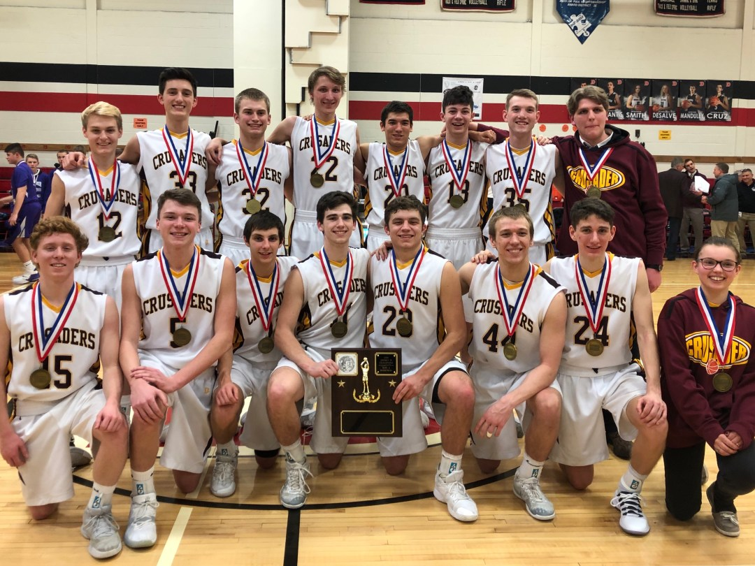 Crusader basketball team claims District 9 basketball title