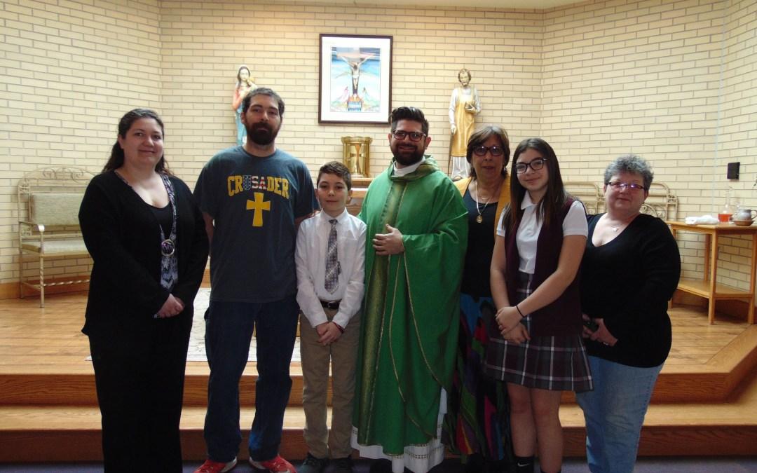 Sixth grader celebrates First Communion at school Mass