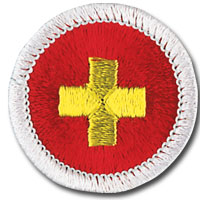 insignia de mérito (merit badge) de primeros auxilios