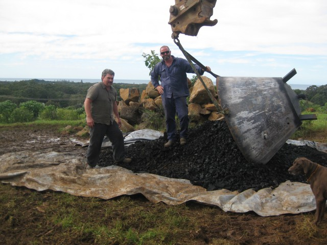 Don Coyne, left, and Kelvin Daly with the finished product: a large pile of valuable 'black gold', or biochar.