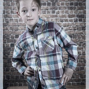 Portrait, portraiture, children's portraits, studio photoshoot, studio photography, walled back drop, walled back drop photography, de-saturated imagery, de-saturated portrait