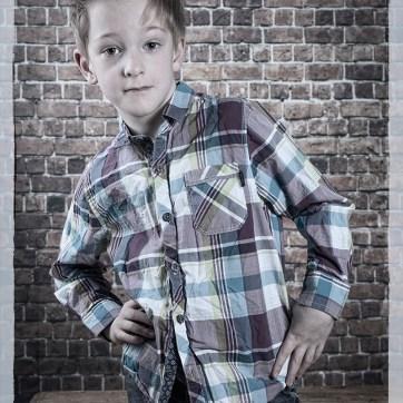 Portrait, portraiture, children's portraits, studio photoshoot, studio photography, walled back drop, walled back drop photography, de-saturated imagery, de-saturated portrait