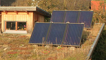 Solar thermal panels, green roof, eco home