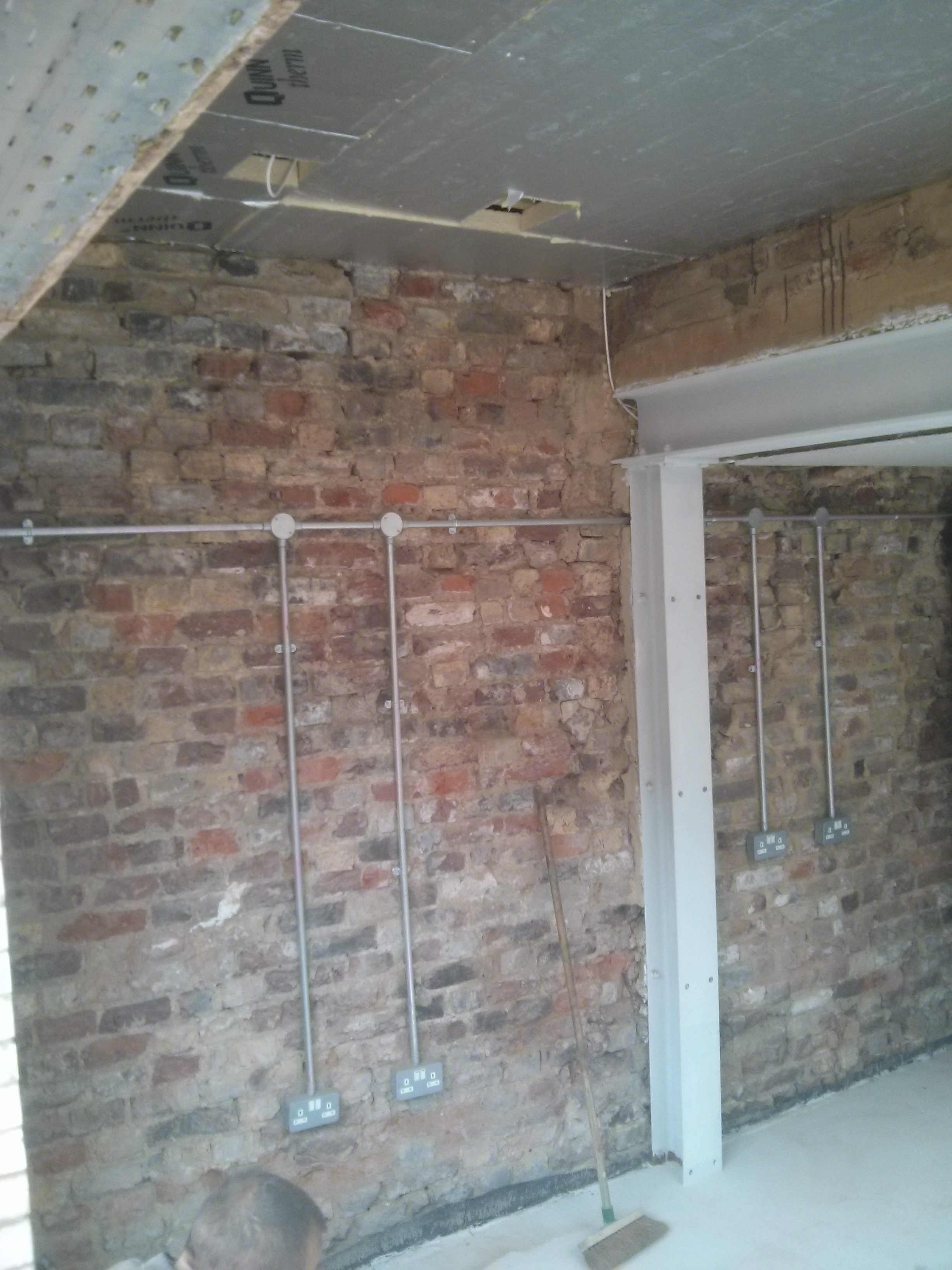 Reclaimed bricks and cladding looking great      Ecoalex All the wiring is in galvanised steel conduit  The exposed bricks will be  protected by