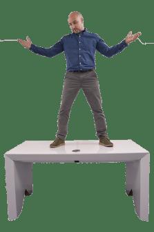 man-standing-on-eco360-cardboard-desk-test-strength-paper