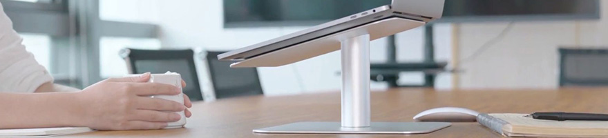 laptop stand on desk