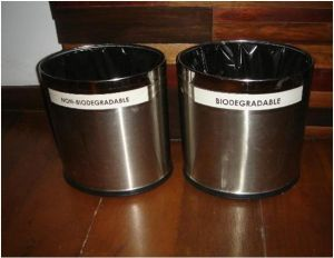 Waste segregation bins with label