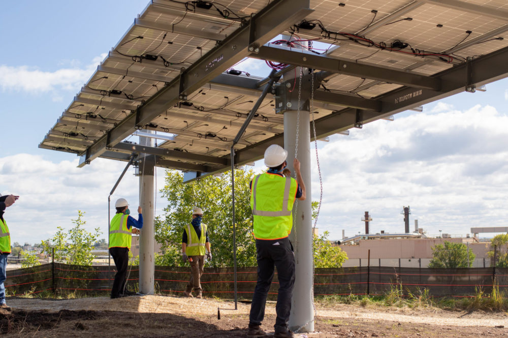 Raising the first panel on the Lincoln Park Solar Garden