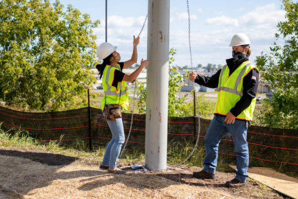 Raising the first panel on the Lincoln Park Solar Garden