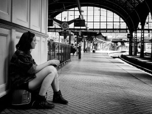 Woman at train station waiting for someone