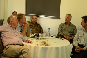 Farmers discussing round a table