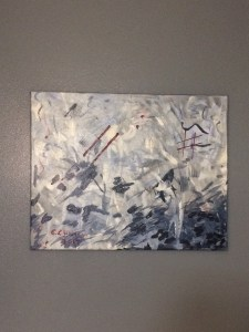 An abstract painting in blues with a splash of red accent.