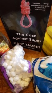 Book surrounded by sources of sugar.