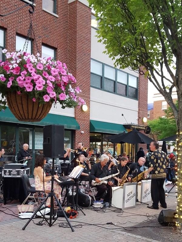 Band playing on sidewalk